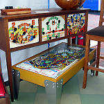 Mike Maxwell incorporates pinball machine parts into his fine furniture.