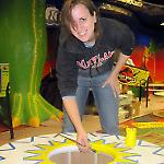 Artist Angela Annecchino paints a giant pop bumper cap.