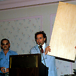 Joe Kaminkow holds a virgin playfield, while Ed Cebulas watches.