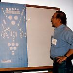 Ed Cebulas examines a paper mockup of Olympiad Pinball.