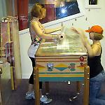 Volunteers wrap a pinball game at the National Pinball Museum.