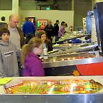 Early shoppers examine the games for sale at the National Pinball Museum.
