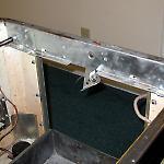 Lockdown mechanism and plunger above the Gottlieb Surf Champ front door