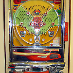 Mizuho pachinko game is flush mounted in gameroom wall.